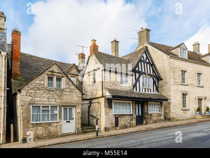 Sightseeing: Historic timbered house and Cotswold stone buildings in New Street, Painswick, an unspoilt village - Stock Photo