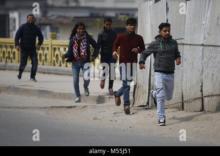 Kathmandu, Nepal. 20th Feb, 2018. People run after a bomb scare in front of the Metropolitan Police circle in Kathmandu, - Stock Photo