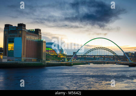 Newcastle upon Tyne UK, view at dusk of the Baltic Centre, Sage Gateshead building and five bridges spanning the - Stock Photo