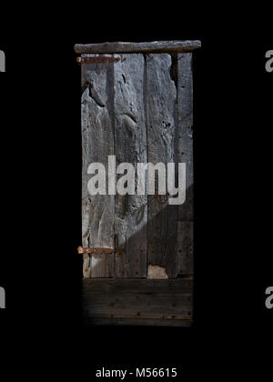 Rustic wood door isolated on black - Stock Photo
