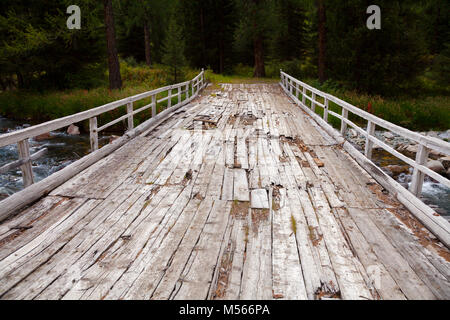 Worn out wooden bridge on a dirt road at Altai Mountains, Western Mongolia - Stock Photo