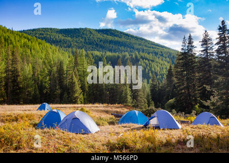 Camping tents on a river shore in wild camping, Altai Mountains, Western Mongolia - Stock Photo