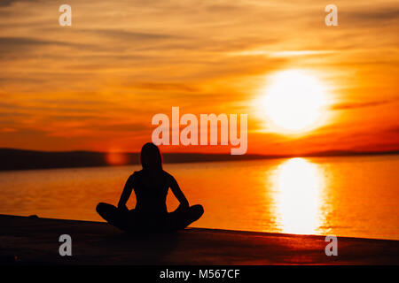 Carefree calm woman meditating in nature.Finding inner peace.Yoga practice.Spiritual healing lifestyle.Enjoying - Stock Photo