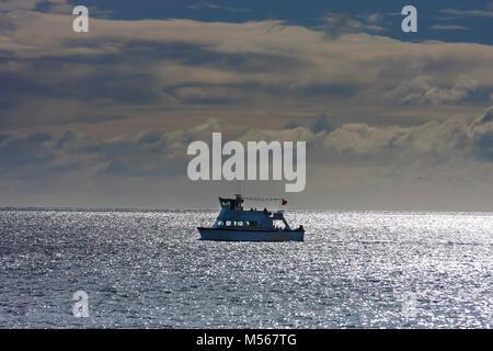 Yacht sailing in Brixham bay in South Devon, UK. - Stock Photo