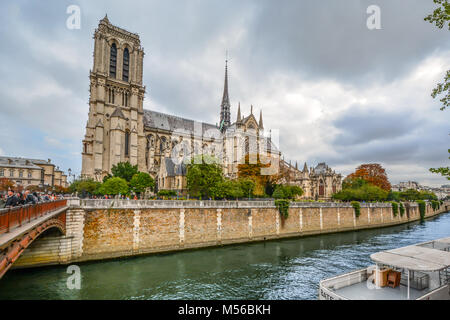 Notre Dame Cathedral and the Seine River on a cloudy day in early autumn on the ile de la cite, Paris France - Stock Photo