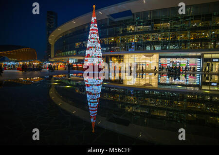 Milan, December 24, 2015 - Gae Aulenti Square in the modern area of Milan near Garibaldi railway station - Stock Photo