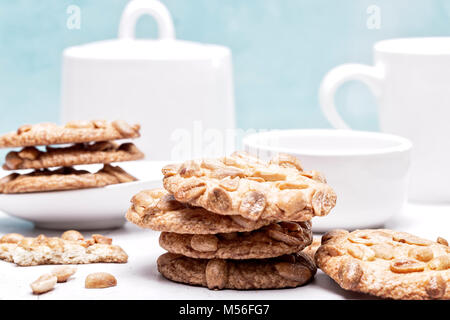 Peanut cookies in a light blue and white kitchen setting - Stock Photo