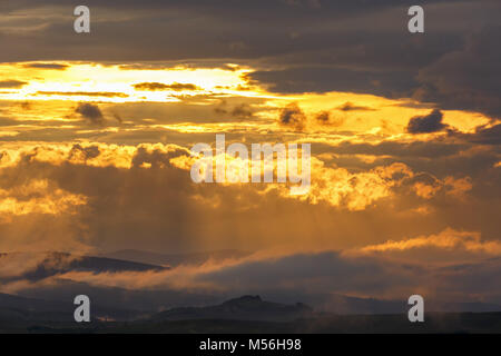 Sunset in a scenic mountain landscape - Stock Photo