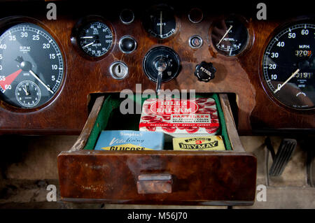 wooden drawer in the dashboard of a 1955 Jaguar Mk VII - Stock Photo