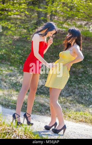 Early pregnancy alpfabet minidress clothing - Stock Photo