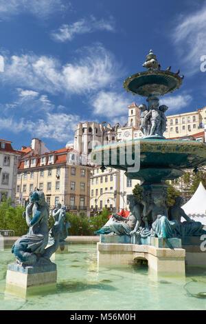 Baroque style bronze fountain on Rossio square. Lisbon. Portugal - Stock Photo