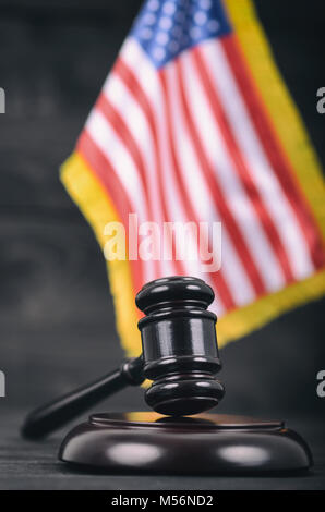Law and Justice, Legality concept, Judge Gavel and United States of America flag on a black wooden background. - Stock Photo