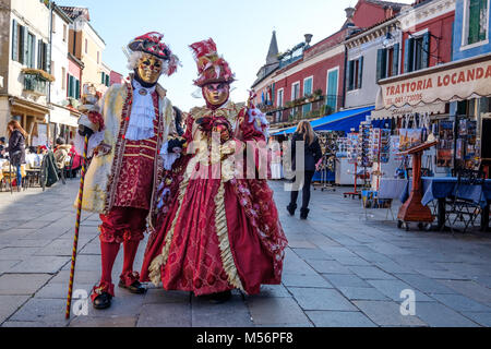 Man and woman wearing red costume during the Carnival of Venice 2018. Venice, Italy. February 2018. - Stock Photo