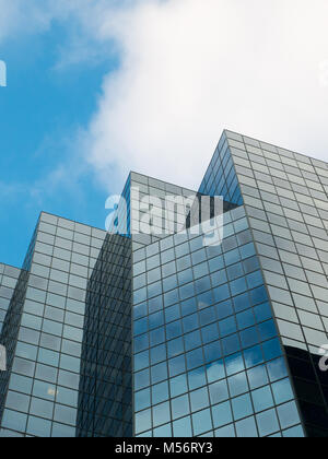 Skyscraper Structure Downtown in Montreal with Sky in Background - Stock Photo