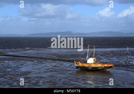 View out to the River Lune from Sunderland Point at low tide with fishing boat moored on mud flats, Sunderland Point, - Stock Photo