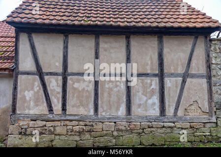 Old half-timbered barn, where you can see the old wood - Stock Photo