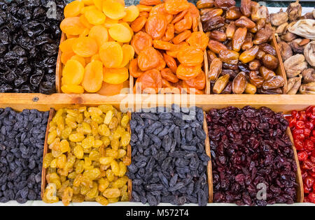 dry fruit mix on a pile on a food market, coloful dry fruits, dried fruits, different types of dry fruits, Assortment - Stock Photo