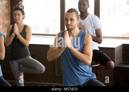Group of sporty people in Tree pose - Stock Photo