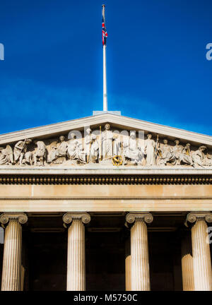 Closeup of portico and pediment sculptures at main entrance of British Museum (dedicated to human history, art and - Stock Photo