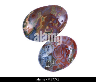 Polished ocean jasper palm stone from Madagascar isolated on white background - Stock Photo