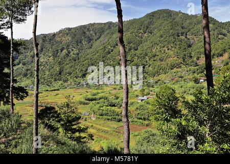 SW-wards view to fields and hamlet of Bugang-Balugang barangay from the S.road going from Lumiang cave area to Sumaguing - Stock Photo