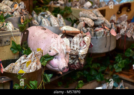 A stall on the borough market in central london selling pig or pork foods and products. Sausages cured and processes - Stock Photo