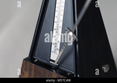 Metronome closeup in action isolated and on a plain background - Stock Photo