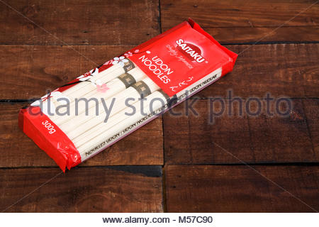 Package of Udon noodles isolated on dark wooden background, with copy space - Stock Photo