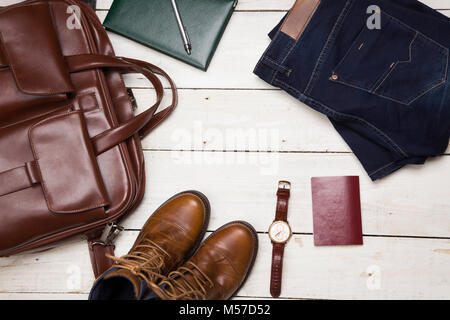 Men's casual outfits with leather accessories on white rustic wooden background, lifestyle traveler, beauty and - Stock Photo