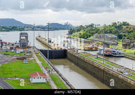 Balboa harbor with entrance or exit channel that leads to the Pacific Ocean (Gulf of Panama) as seen from the Miraflores - Stock Photo