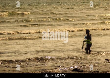 Silhouette of fisherman using nets to catch fish. Fishermen hold the fishing nets at a beach - Stock Photo