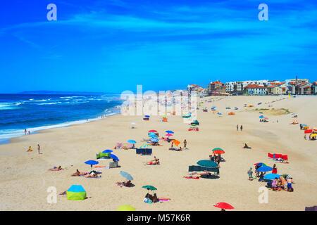 ESPINHO, PORTUGAL - JUL 30, 2017: People at the ocean beach in a high peak season. Portugal famous tourist destination - Stock Photo