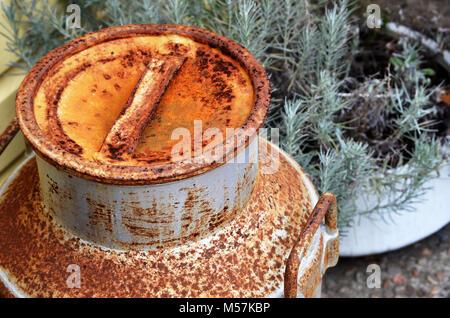 Old rusted milk pail at Bodalla Dairy NSW Australia - Stock Photo