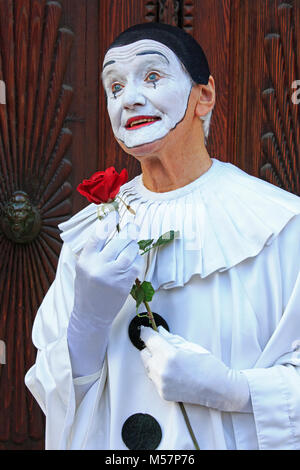 A mime artist holding a rose during the Carnival of Venice (Carnevale di Venezia) in Venice, Italy - Stock Photo
