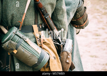 Parts of the German soldier's outfit Wehrmacht, flask, rifle and gas mask in the container - Stock Photo
