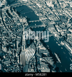 Split tone image of aerial view of Central London from above the Shard with views along the Thames from HMS Belfast - Stock Photo