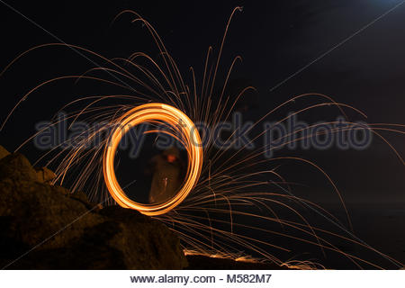Steel wool photography light painting in Galway, Ireland. My first time playing with fire and long exposure on a - Stock Photo