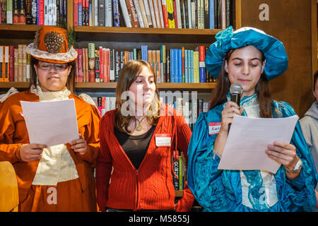 Libba Bray Shannon Hale fiction authors literature teen girls dressed up characters Black reading microphone - Stock Photo