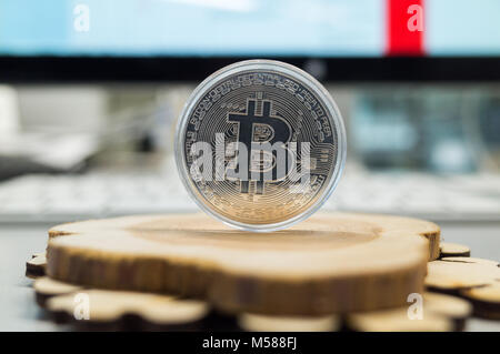 Silver bitcoin on a wooden background - Stock Photo