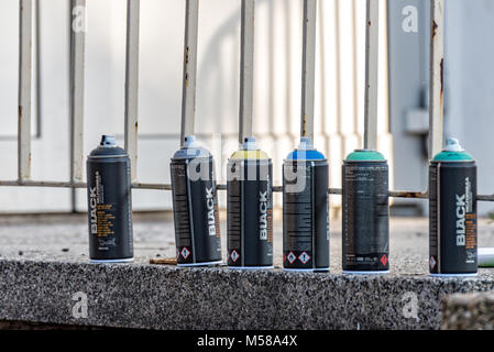 Colorful spray cans are ready for use - Stock Photo