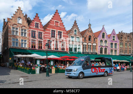 Sightseeing tour bus in Grote Markt (Market Square), Bruges, Belgium - Stock Photo