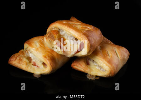 Puff pastry with meat and cheese on a dark background - Stock Photo