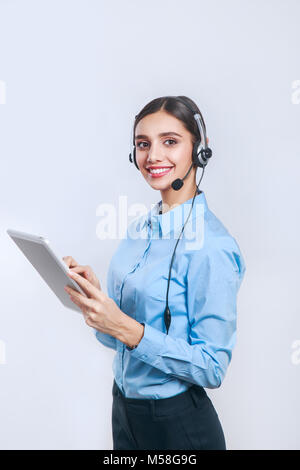 Female customer support operator with tablet. Call center operator - Stock Photo