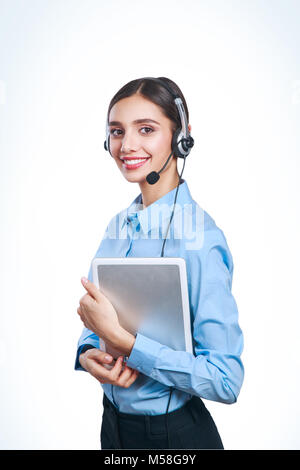 Support phone operator in headset with tablet on white background - Stock Photo