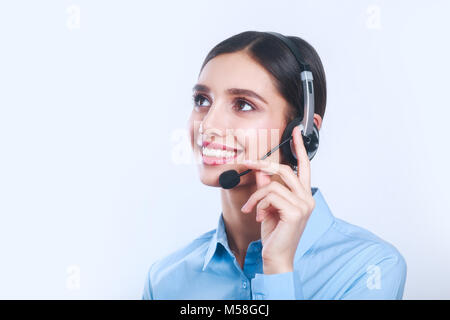 Indian businesswoman working in call center and looking up - Stock Photo