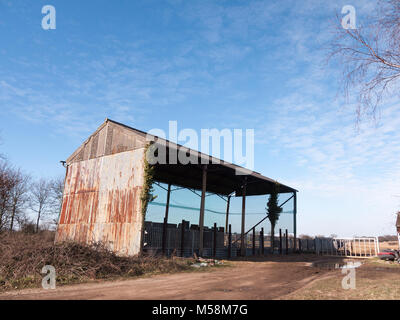 old farm land cow shed blue sky agriculture pen; essex; england; uk - Stock Photo