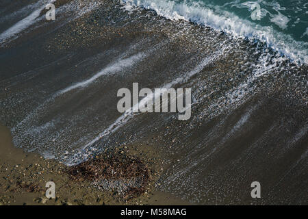 Photo of sea sandy coast with waves - Stock Photo