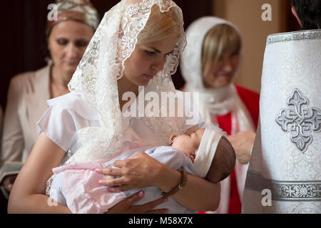 Belarus, the city of Gomel. June 10, 2017. Church at the regional hospital. The baptism of a child.The mother holds - Stock Photo