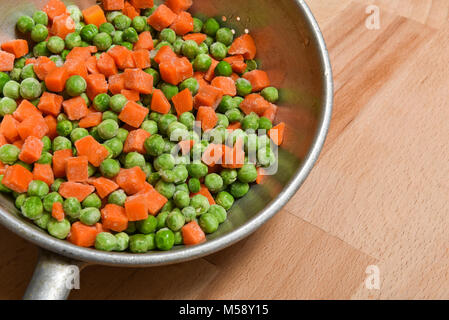 frozen peas and carrots - Stock Photo