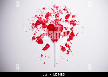 broken heart shaped lollipop - Stock Photo